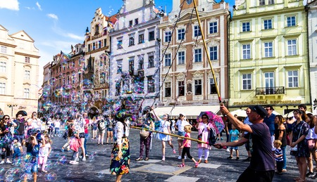 Prague, Czech Republic -July 23,2017: Street performer making bubbles to entertain people at Staromestske namesti Old Town Square