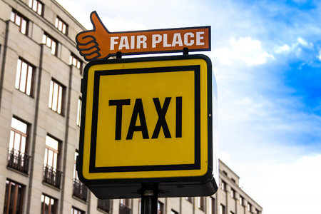 Prague, Czech Republic -July 23,2017: Information sign of a Taxi and Fair place on the background of houses