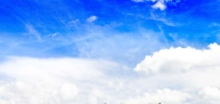 Blue sky with white clouds. 報道画像