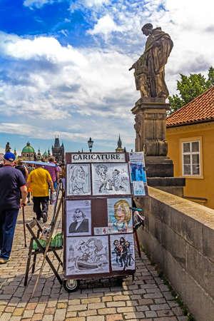 Prague, Czech Republic -July 23,2017: Street artists located on Charles Bridge and are very popular with tourists Redakční