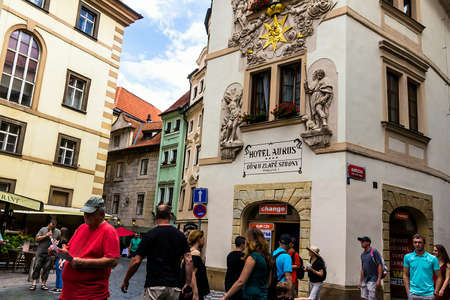 Prague, Czech Republic -July 23,2017: Tourists on the medieval Karlova street of the old part of the city near hotel Aurus