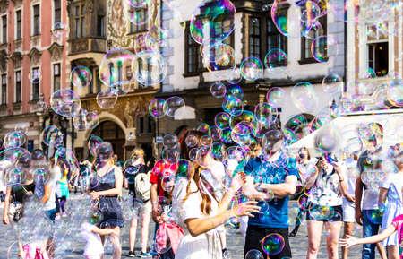 Prague, Czech Republic. Street performer making bubbles to entertain people at Staromestske namesti Old Town Square Redakční