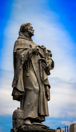 The historic statue at the Charles Bridge in Prague, Czech Republic.