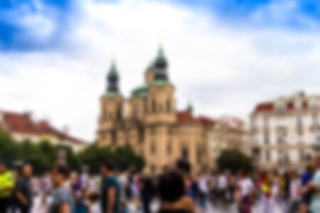Old Town Square with tourists in one of European city. Blurred view