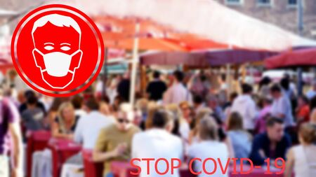 Coronavirus and Air pollution concept. Stop COVID-19. Medical protective mask sign on European city blurred background.