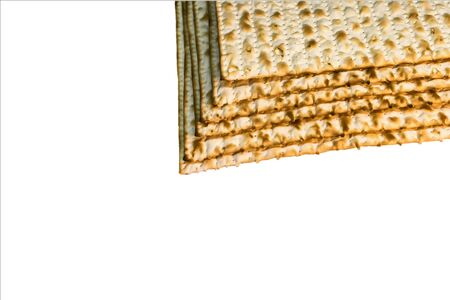 Pile of Jewish Matzah bread, the substitute for bread on the Jewish Passover holiday. Pesach matzo on white background