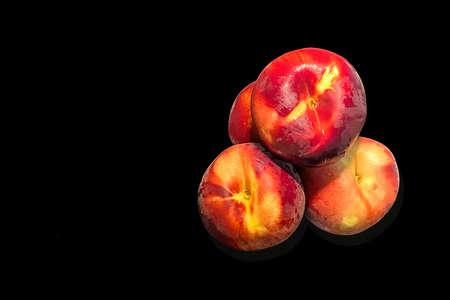 Fresh red peaches isolated on black background Reklamní fotografie