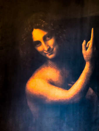 "Tel Aviv, Israel - March 6, 2019: Copy of the painting ""St. John the Baptist"" by Leonardo da Vinci at The exhibition of Leonardo da Vinci - 500 years old."