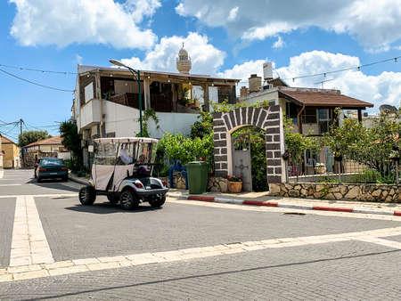 Kfar Kama, Israel- April 11, 2019: Typical modern residential building in Kfar Kama - Circassian village in Israel. Electric car at the street.