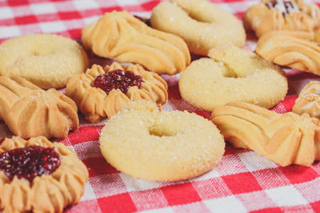 Confectionery, restaurant, coffee shop, pastry shop. Delicious cookies on the table on the paper background.