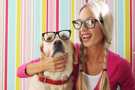 labrador teeth: Happy girl and her dog in vintage glasses at stripe bright color background