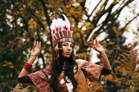pocahontas: Indian girl, ritual dance, painted face, autumn Stock Photo