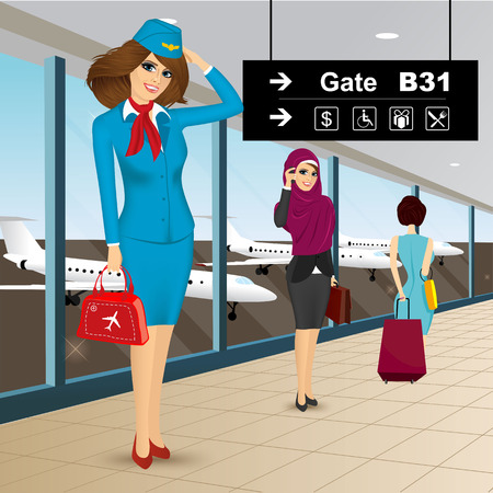 portrait of beautiful friendly air hostess saluting in an airport