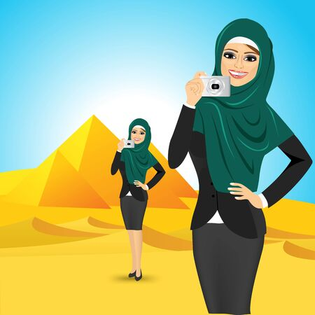 egyptian woman: portrait of young smiling modern Arabic woman taking a picture against Egyptian pyramids