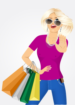 stop gesture: portrait of young beautiful blonde woman with sunglasses and multicolored shopping bags showing stop gesture isolated over white background