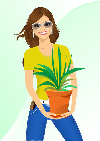 offiice: smiling woman with glasses holding chlorophytum in a pot