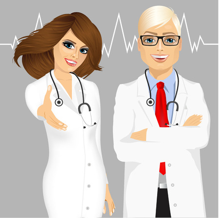 experienced: portrait of experienced male doctor with arms folded and smiling female doctor giving a hand for handshake