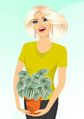 offiice: smiling blonde woman holding peperomia marmorata in a pot isolated on blue background