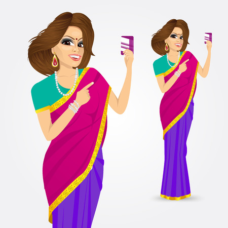 saree: portrait of traditional indian woman pointing at a credit card  isolated over white background