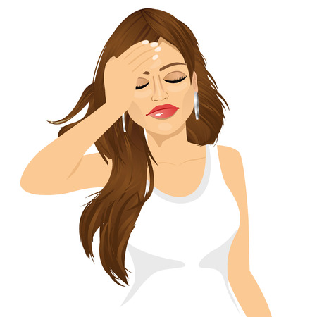 headache: portrait of brunette woman touching her head suffering a painful headache isolated over white background