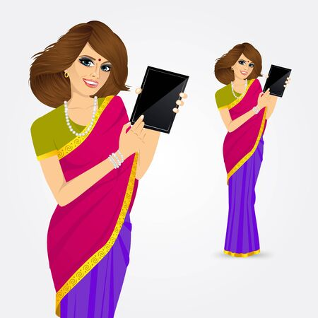 using tablet: portrait of traditional Indian woman using a tablet computer  isolated over white background
