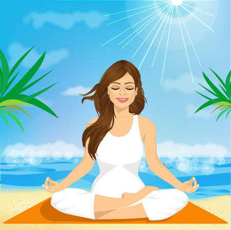 yoga outside: portrait of a beautiful young woman sitting in yoga pose at the beach
