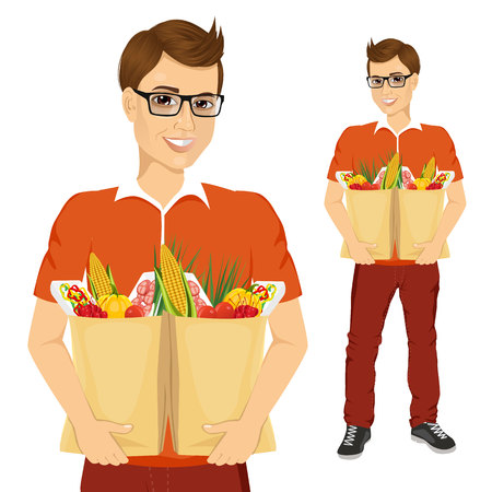 paper bags: portrait of young man with glasses carrying grocery paper bags full of healthy vegetables and other food