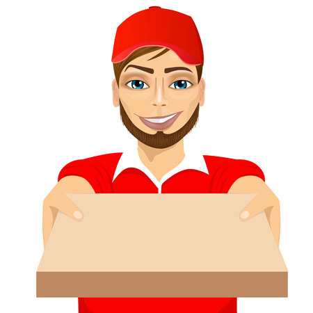 delivering: portrait of happy young pizza delivery guy holding pizza cardboard delivering order isolated on white background