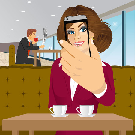 woman smartphone: portrait of happy brunette woman taking a selfie using her smartphone at a coffee shop isolated over white background