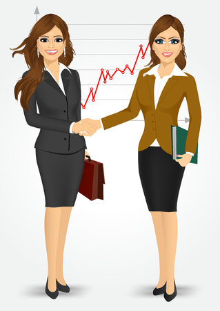 negotiating: two businesswomen with briefcase and paper folder shaking hands happy standing negotiating on background of line chart