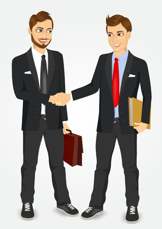 negotiating: two young businessmen shaking hands happy standing negotiating