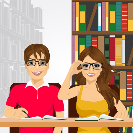 nerdy: a pair of university students with open books and eyeglasses styding in the college library