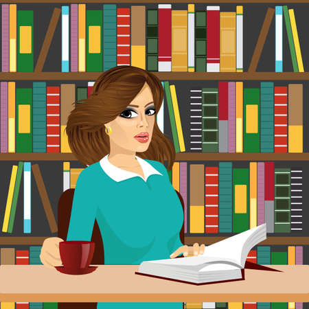 girl happy: portrait of friendly brunette student girl happy studying in library reading a textbook and drinking tea or coffee