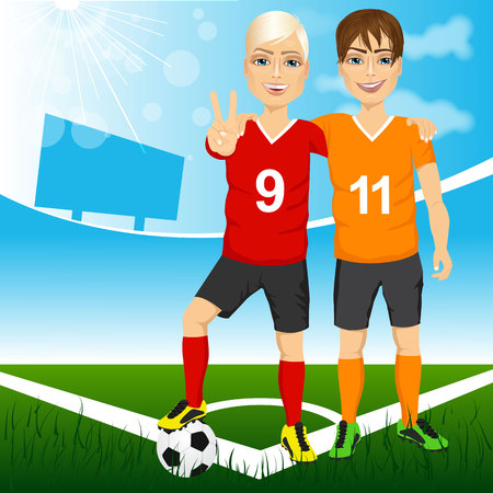 Dos jugadores de fútbol de amigos y rivales de competir equipos juntos en un campo de fútbol