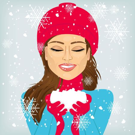 woman in scarf: attractive brunette woman with eyes closed and smiling in red winter hat and scarf holding snow