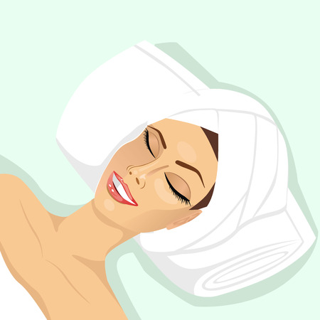people, beauty, spa, healthy lifestyle and relaxation concept - close up of beautiful young woman lying with closed eyes in spa