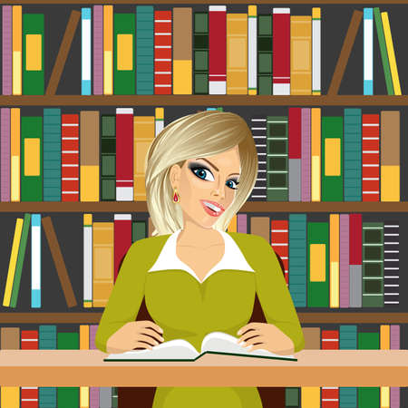 girl happy: portrait of friendly blonde student girl happy studying in library reading a textbook