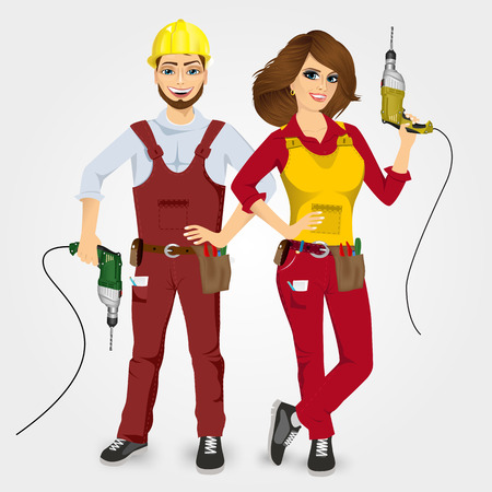 handywoman: portrait of handyman and handywoman in uniform holding drills isolated on white background