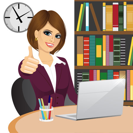 successful businesswoman making thumbs up gesture sitting in office