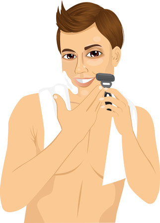 male grooming: portrait of handsome young man shaving with razor over white background