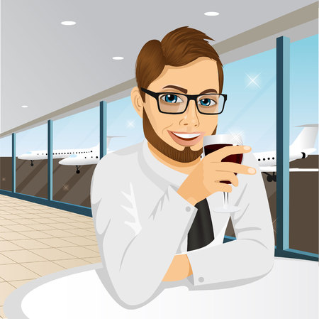 a charming: Handsome young businessman with glasses drinking wine in restaurant at airport