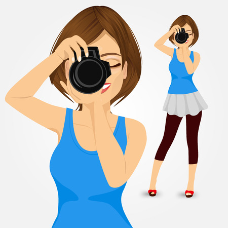 reflex camera: attractive happy young photographer woman taking photos using her digital reflex camera