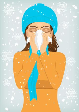 nariz: atractiva mujer que llevaba una gorra y el sufrimiento bufanda de punto de influenza cálido y escurrimiento nasal que sopla la nariz con un pañuelo