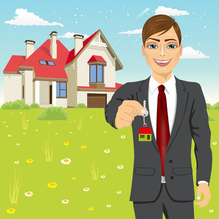 real estate house: portrait of real estate agent holding the key of a new house