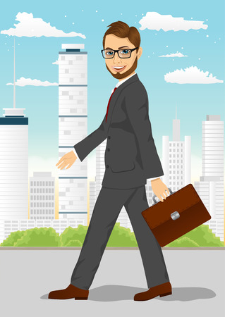 walk through: portrait of handsome active hipster businessman with glasses and briefcase walking through the city