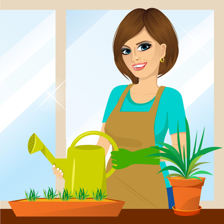 plant stand: attractive lovely housewife on the balcony holding watering can