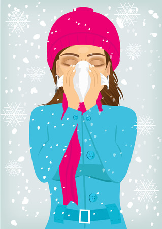 runny: beautiful woman wearing a warm knitted cap and scarf suffering influenza and runny nose blowing her nose with a handkerchief