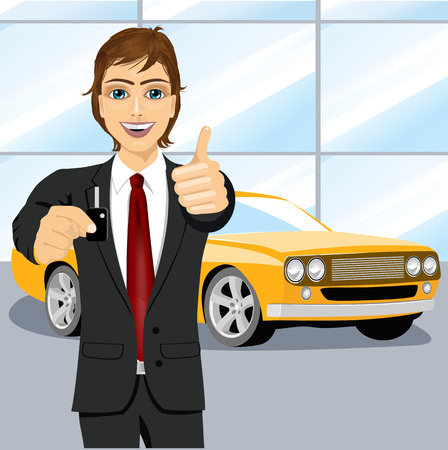 brand new: portrait of young handsome automobile salesman holding the key of a brand new yellow car and showing thumbs up into car showroom