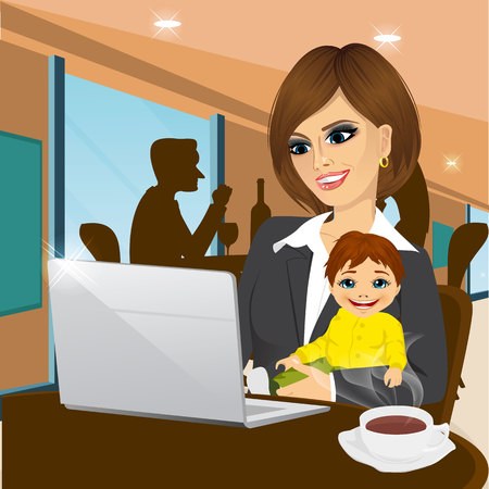 maternity leave: smiling mother working on laptop in cafe while holding little baby boy