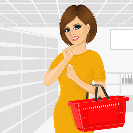 pre adult: Thoughtful woman holding an empty shopping basket isolated on white background